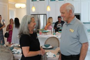 GH Homes Cora Johnston and Realtor Bob Holmquist at Sea View Grand Opening.